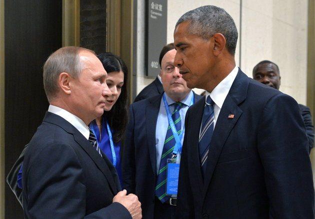 נשיא ארצות הברית ברק אובמה ונשיא רוסיה ולדימיר פוטין. תמונה: ALEXEI DRUZHININ