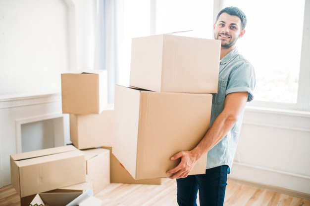 smiling-young-man-holds-cardboard-boxes-hands-housewarming-moving-new-house_266732-11006-a4b1e7c9