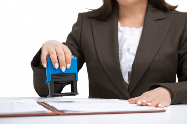 businesswoman-putting-stamp-documents-isolated-white-background_256259-113-fd5ed1c7