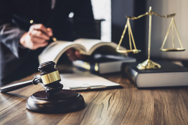 lawyer-judge-counselor-working-with-agreement-contract-courtroom_28283-730-68afb03b